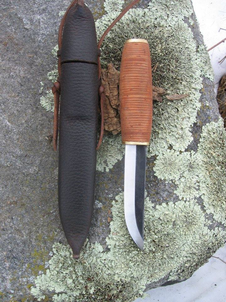 Stacked birch bark handle Pukkoo knife in an early style capped neck sheath